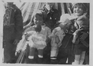 Sara and Mamie with dolls; striped teepee in background