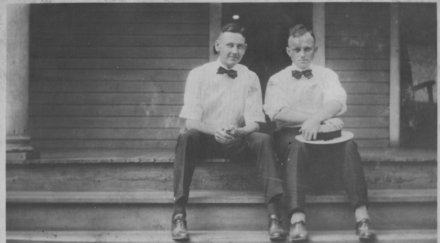 Howard Evans (right) and unidentified friend at Buckeye Cottonseed Oil Mill, circa 1920