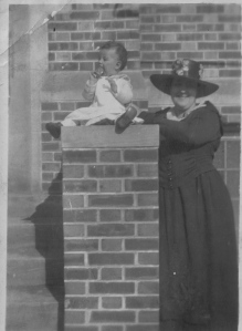 "Jessie West Evans with her first daughter, Jessie (""Tiny), on the steps of the Greenwood Leflore Public Library."
