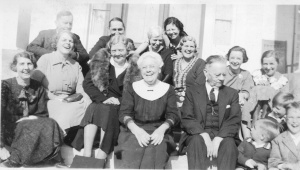 A laughing Lizzie George Henderson, middle front row, on the steps of her father's home, Cotesworth. Pictures of Miss Lizzie smiling are very rare.